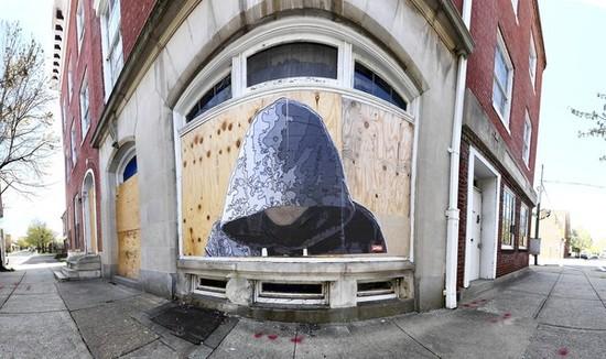 http://articles.baltimoresun.com/2012-03-30/news/bs-ae-trayvon-mural-20120330_1_baltimore-street-paste-street-artists